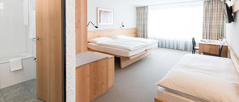 Switzerland_St-Moritz_Hotel-Hauser_Triple-bedroom.jpg